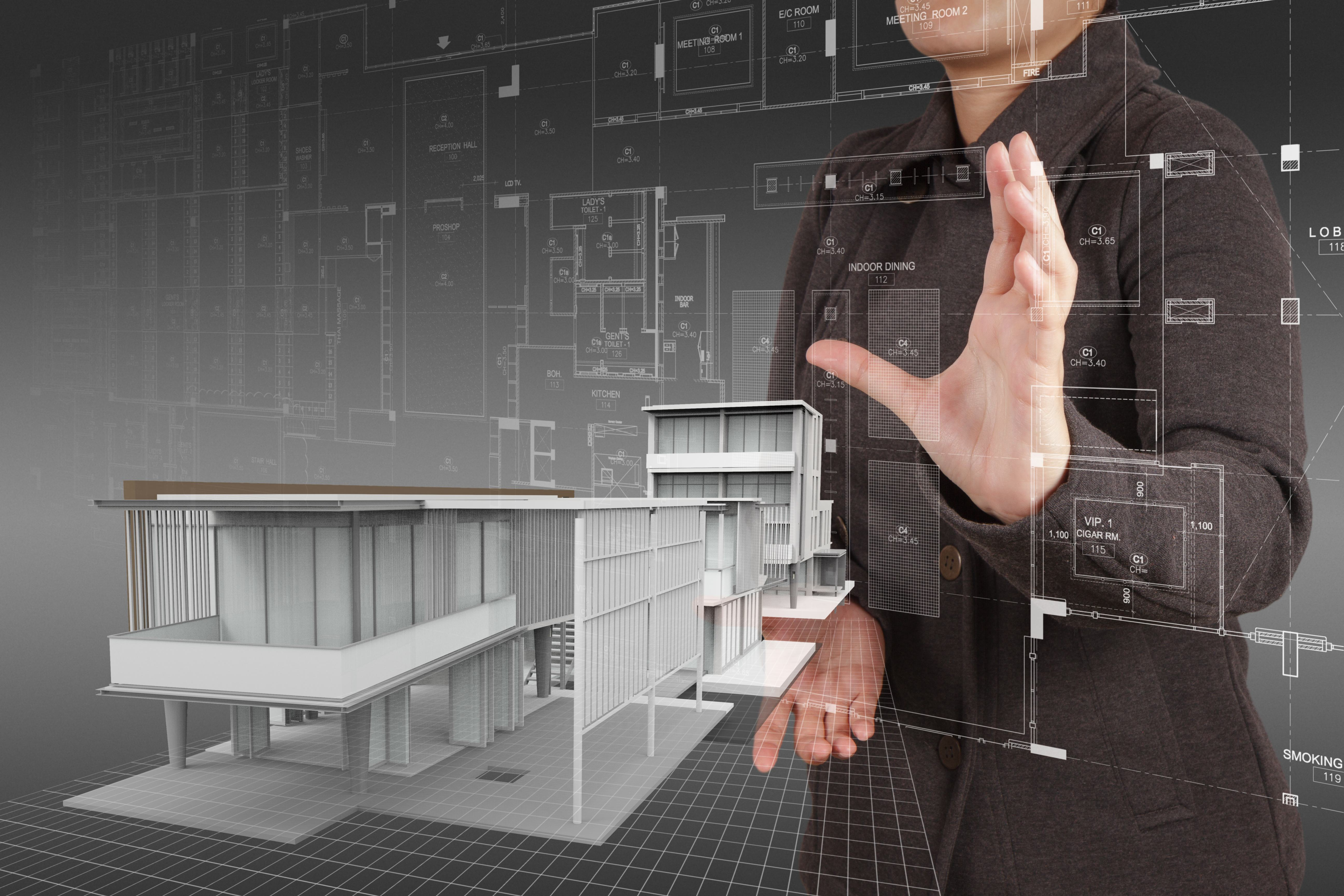 businesswoman hand shows house model as concept