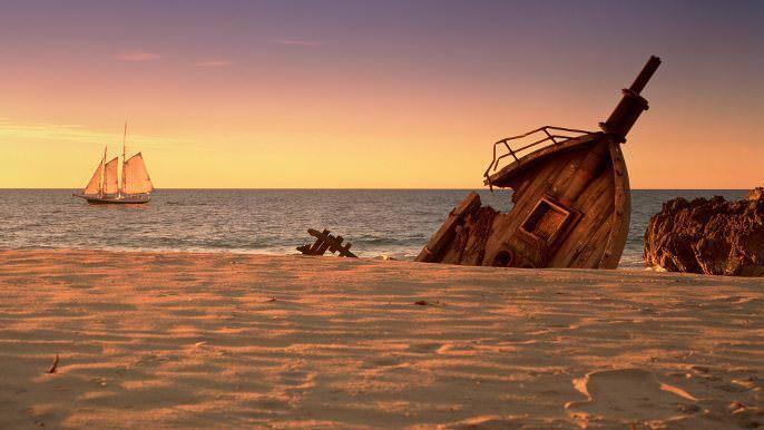 shipwreck bow buried sand beach schooner sailing